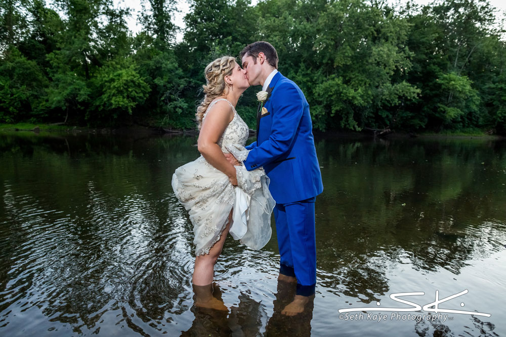 bride and groom in the water