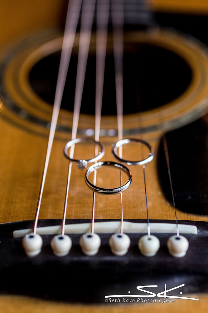 wedding rings on a guitar
