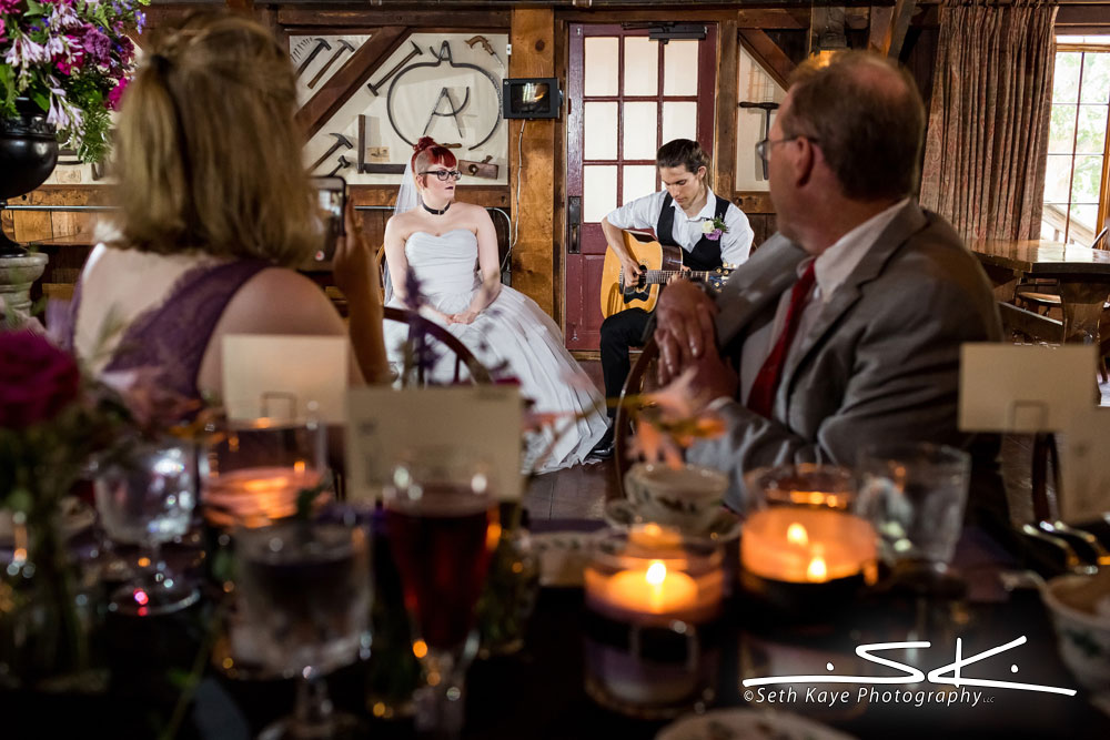bride and groom singing and playing guitar